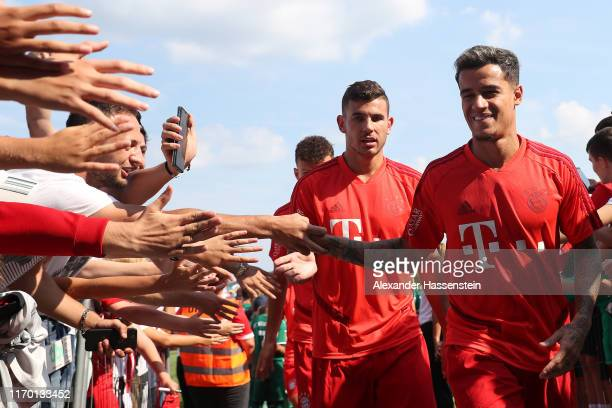 Philippe Coutinho of FC Bayern Muenchen smiles with his team mate Lucas Hernandez prior to the Traumspiel between Vilshofen Rot Weiss and FC Bayern...