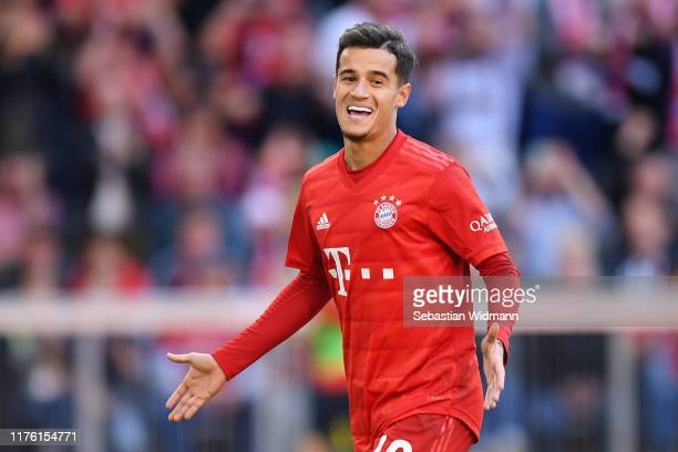 Philippe Coutinho of FC Bayern Munich celebrates as he scores his team's third goal from a penalty during the Bundesliga match between FC Bayern...
