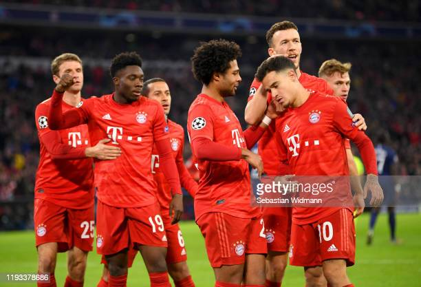 Philippe Coutinho of FC Bayern Munich celebrates with teammates after scoring his team's third goal during the UEFA Champions League group B match...