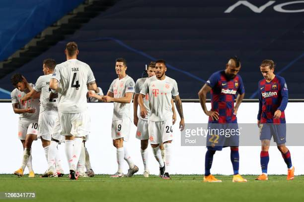 Philippe Coutinho of FC Bayern Munich celebrates with teammates after scoring his team's eighth goal during the UEFA Champions League Quarter Final...