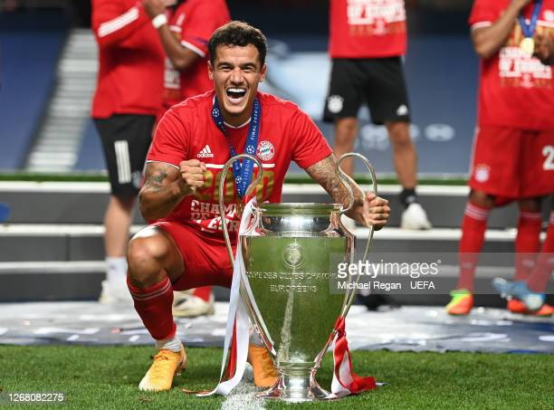 Philippe Coutinho of FC Bayern Munich celebrates with the UEFA Champions League Trophy following his team's victory in the UEFA Champions League...