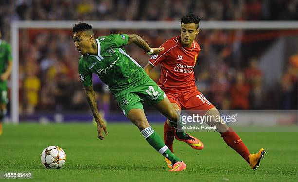 Philippe Coutinho of Liverpool and Anicet Abel of PFC Ludogorets compete during the UEFA Champions League match between Liverpool and PFC Ludogorets...