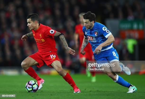 Philippe Coutinho of Liverpool and Harry Arter of AFC Bournemouth battle for possession during the Premier League match between Liverpool and AFC...