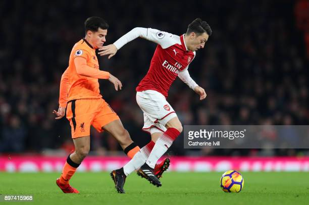 Philippe Coutinho of Liverpool and Mesut Ozil of Arsenal during the Premier League match between Arsenal and Liverpool at Emirates Stadium on...