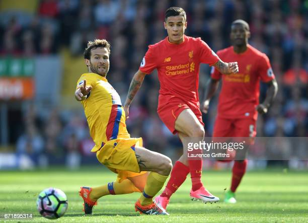 Philippe Coutinho of Liverpool and Yohan Cabaye of Crystal Palace compete for the ball during the Premier League match between Liverpool and Crystal...