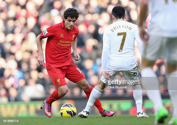 Philippe Coutinho of Liverpool attempts to move past Leon Britton of Swansea during the Barclays Premier League match between Liverpool and Swansea...