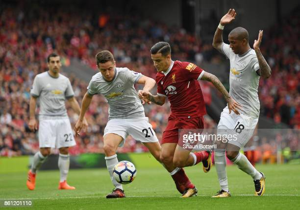 Philippe Coutinho of Liverpool battles for possession with Ander Herrera and Ashley Young of Manchester United during the Premier League match...