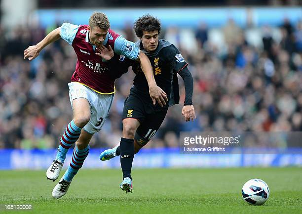 Philippe Coutinho of Liverpool battles with Nathan Baker of Aston Villa during the Barclays Premier League match between Aston Villa and Liverpool at...