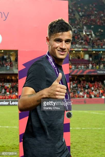 Philippe Coutinho of Liverpool celebrates after beating Leicester City 21 in the final during the Premier League Asia Trophy match between Liverpool...