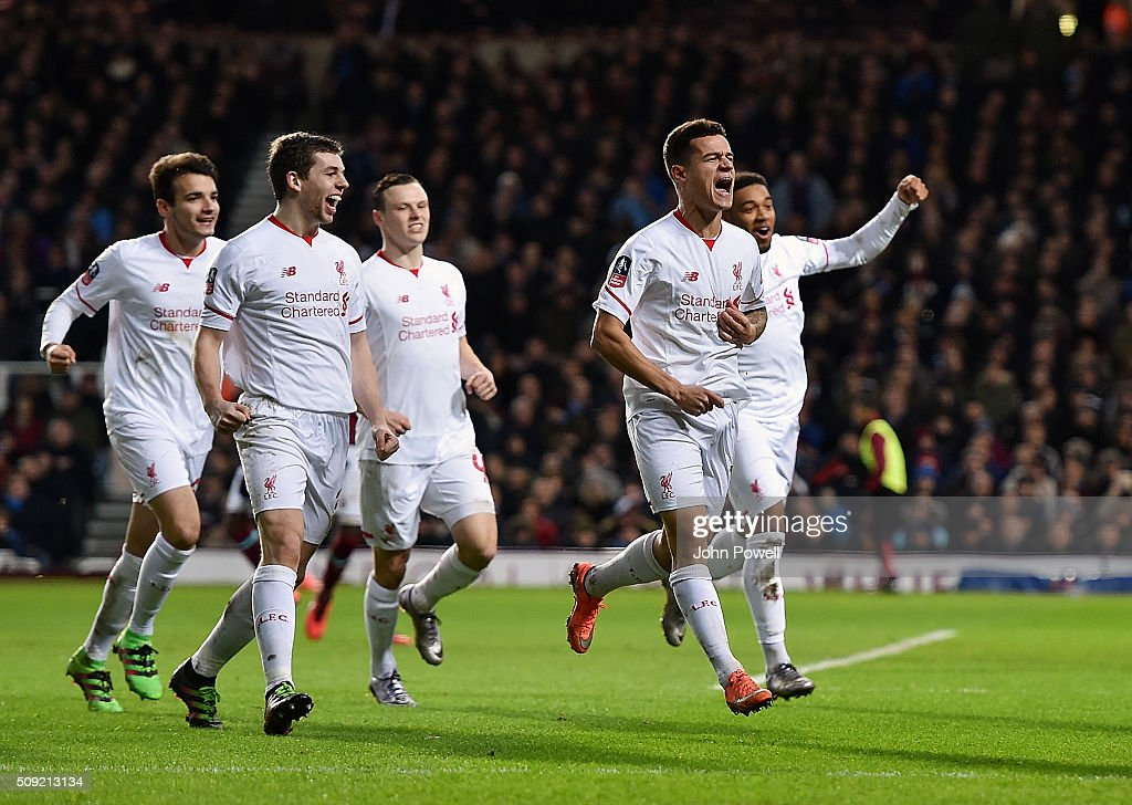 Philippe Coutinho of Liverpool celebrates after scoring a free-kick during the The Emirates FA Cup Fourth Round Replay match between West Ham United and Liverpool at Boleyn Ground on February 9, 2016 in London, England.