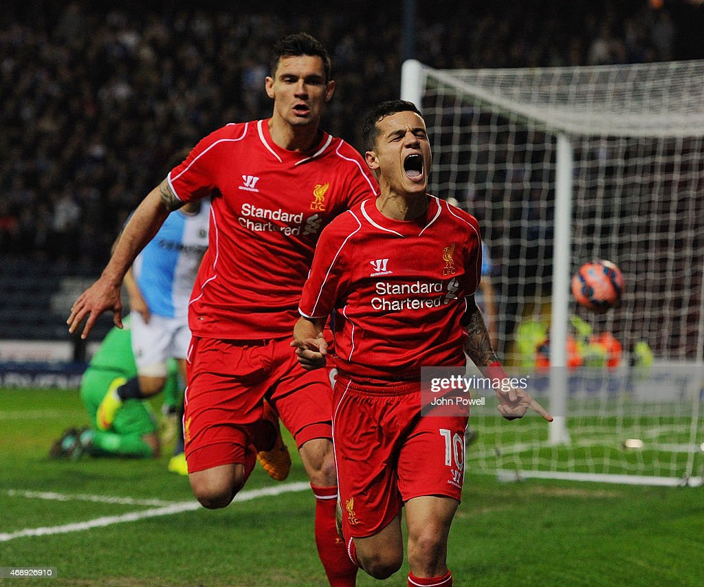 Philippe Coutinho of Liverpool celebrates after scoring during the FA Cup Quarter Final Replay match between Blackburn Rovers and Liverpool at Ewood park on April 8, 2015 in Blackburn, England.