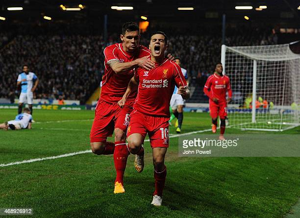 Philippe Coutinho of Liverpool celebrates after scoring during the FA Cup Quarter Final Replay match between Blackburn Rovers and Liverpool at Ewood...