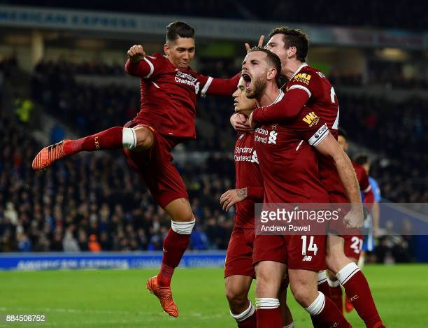 Philippe Coutinho of Liverpool celebrates after scoring during the Premier League match between Brighton and Hove Albion and Liverpool at Amex...