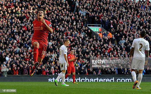 Philippe Coutinho of Liverpool celebrates after scoring his first goal for the club during the Barclays Premier League match between Liverpool and...