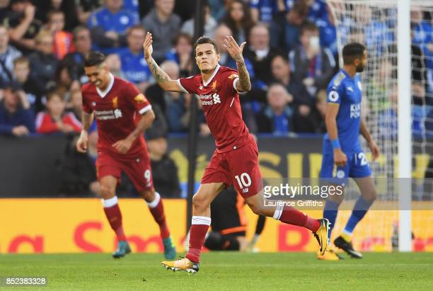 Philippe Coutinho of Liverpool celebrates after scoring his sides second goal during the Premier League match between Leicester City and Liverpool at...
