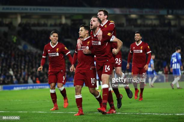 Philippe Coutinho of Liverpool celebrates after scoring his sides fourth goal with his team mates during the Premier League match between Brighton...