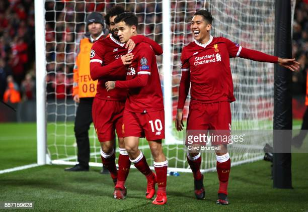Philippe Coutinho of Liverpool celebrates after scoring his sides fifth goal with Mohamed Salah of Liverpool and Roberto Firmino of Liverpool during...