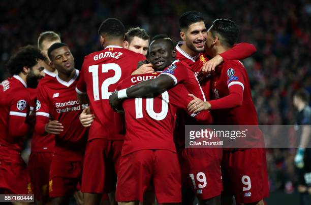 Philippe Coutinho of Liverpool celebrates after scoring his sides fifth goal with his team mates during the UEFA Champions League group E match...