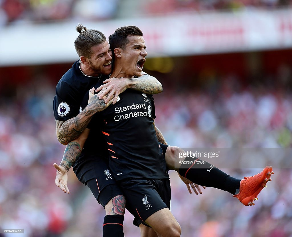 Philippe Coutinho of Liverpool celebrates after scoring the equalising goal during the Premier League match between Arsenal and Liverpool at Emirates Stadium on August 14, 2016 in London, England.