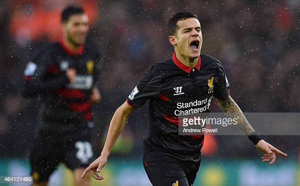 Philippe Coutinho of Liverpool celebrates after scoring the opening goal during the Barclays Premier League match between Southampton and Liverpool...
