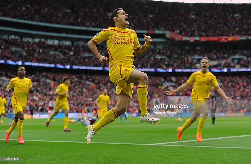 Philippe Coutinho of Liverpool celebrates after scoring the opening goal during the FA Cup Semi-Final match between Aston Villa and Liverpool at Wembley Stadium on April 19, 2015 in London, England.