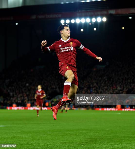 Philippe Coutinho of Liverpool celebrates after scoring the opening goal during the Premier League match between Liverpool and Swansea City at...