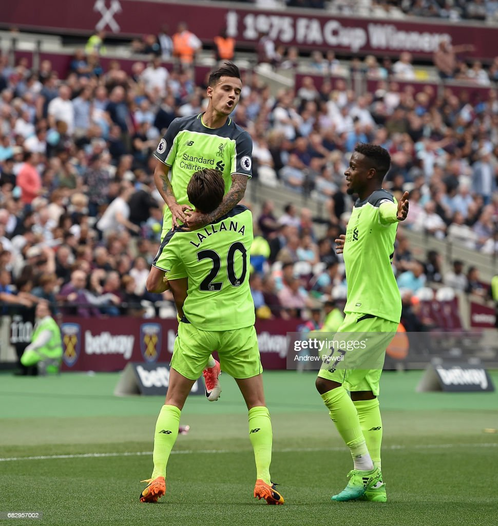 Philippe Coutinho of Liverpool celebrates after scoring the third goal during the Premier League match between West Ham United and Liverpool at London Stadium on May 14, 2017 in Stratford, England.
