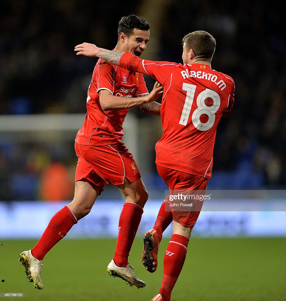 Philippe Coutinho of Liverpool celebrates after scoring the winning goal during the FA Cup Fourth Round Replay match between Bolton Wanderers and Liverpool at Macron Stadium on February 4, 2015 in Bolton, England.