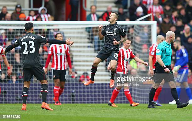 Philippe Coutinho of Liverpool celebrates as he scores their first goal during the Barclays Premier League match between Southampton and Liverpool at...