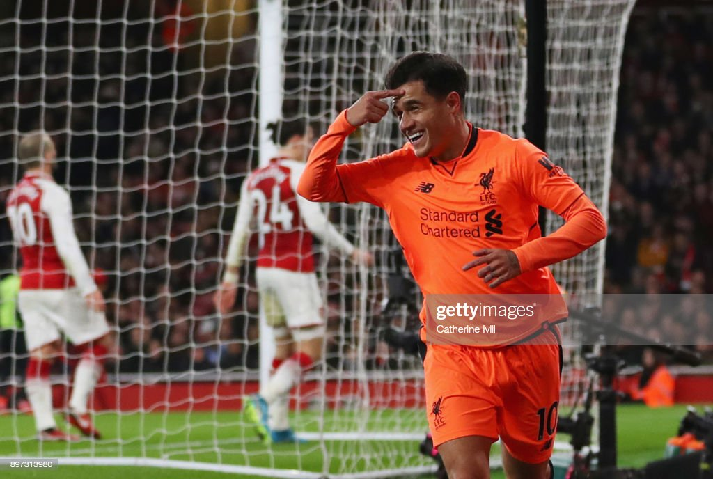Philippe Coutinho of Liverpool celebrates as he scores their first goal during the Premier League match between Arsenal and Liverpool at Emirates Stadium on December 22, 2017 in London, England.