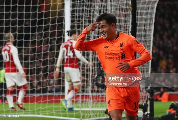 Philippe Coutinho of Liverpool celebrates as he scores their first goal during the Premier League match between Arsenal and Liverpool at Emirates...