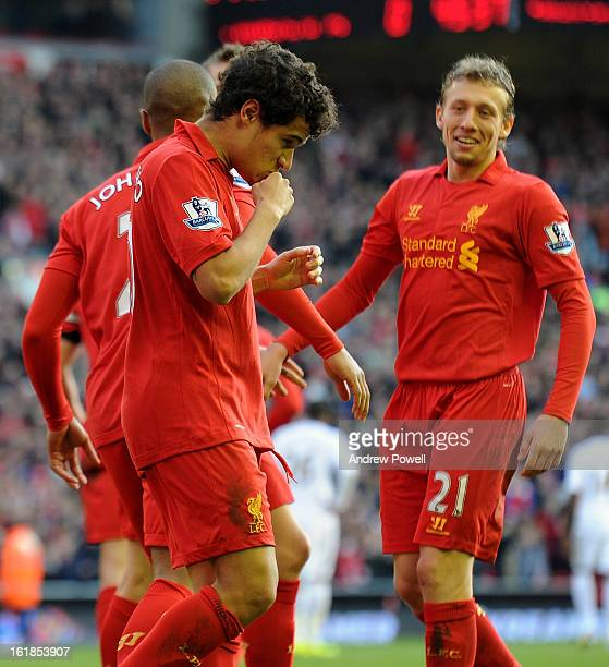 Philippe Coutinho of Liverpool celebrates his goal as Lucas Leiva smiles on during the Barclays Premier League match between Liverpool and Swansea...