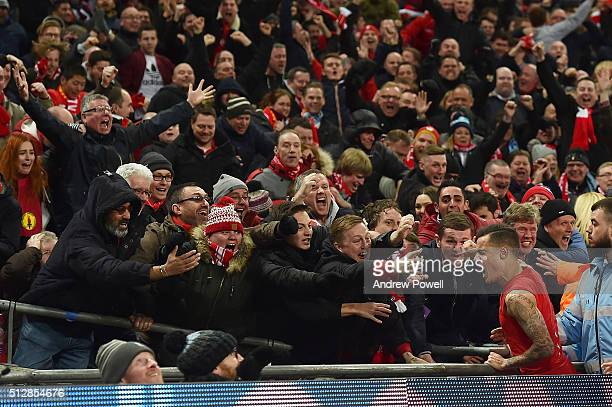Philippe Coutinho of Liverpool celebrates his goal during the Capital One Cup Final match between Liverpool and Manchester City at Wembley Stadium on...