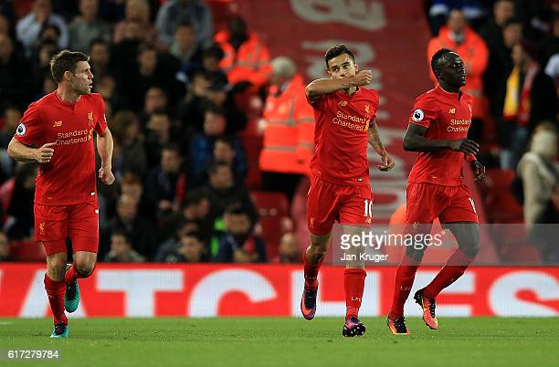 Philippe Coutinho of Liverpool celebrates his goal during the Premier League match between Liverpool and West Bromwich Albion at Anfield on October...