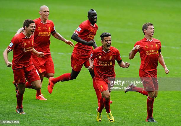 Philippe Coutinho of Liverpool celebrates his goal with Steven Gerrard and teammates to make it 32 during the Barclays Premier Leuage match between...
