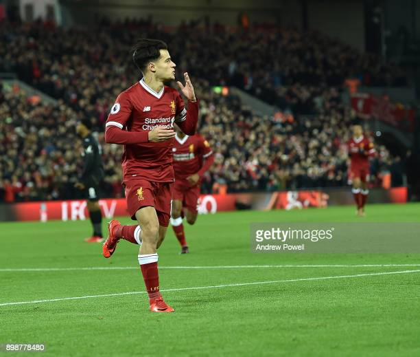 Philippe Coutinho of Liverpool Celebrates his openong goal during the Premier League match between Liverpool and Swansea City at Anfield on December...