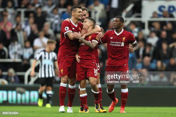 Philippe Coutinho of Liverpool celebrates scoring a goal to make the score 01 during the Premier League match between Newcastle United and Liverpool...