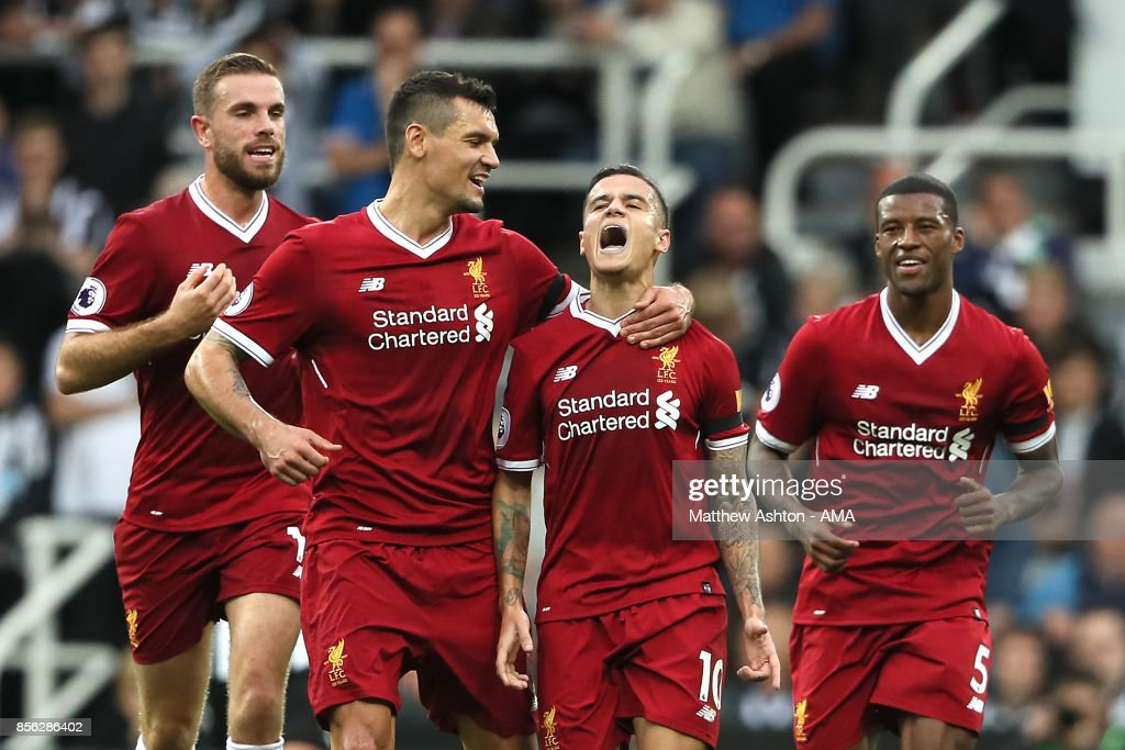 Philippe Coutinho of Liverpool celebrates scoring a goal to make the score 0-1 during the Premier League match between Newcastle United and Liverpool at St. James' Park on October 1, 2017 in Newcastle upon Tyne, England.