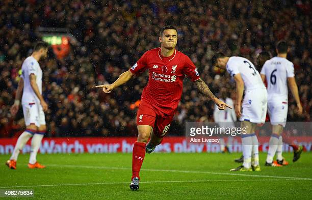 Philippe Coutinho of Liverpool celebrates scoring his side's first goal during the Barclays Premier League match between Liverpool and Crystal Palace...