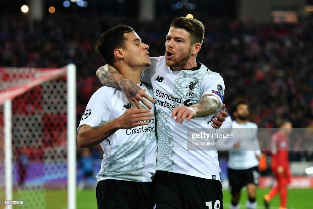 Philippe Coutinho of Liverpool celebrates scoring his sides first goal with Alberto Moreno of Liverpool during the UEFA Champions League group E match between Spartak Moskva and Liverpool FC at Otkrytije Arena on September 26, 2017 in Moscow, Russia.
