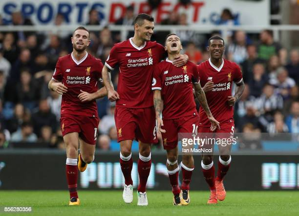 Philippe Coutinho of Liverpool celebrates scoring his sides first goal with Dejan Lovren of Liverpool during the Premier League match between...