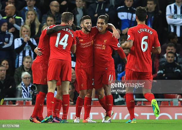Philippe Coutinho of Liverpool celebrates scoring his sides second goal with his team mates during the Premier League match between Liverpool and...