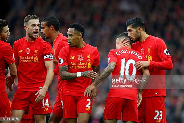 Philippe Coutinho of Liverpool celebrates scoring his sides second goal with Emre Can of Liverpool and team mates during the Premier League match...