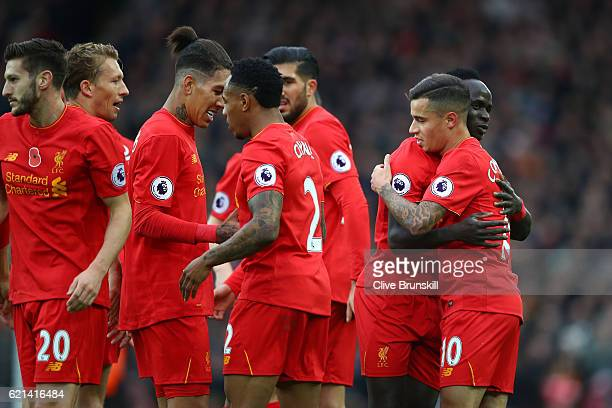 Philippe Coutinho of Liverpool celebrates scoring his sides second goal with Sadio Mane of Liverpool and team mate during the Premier League match...