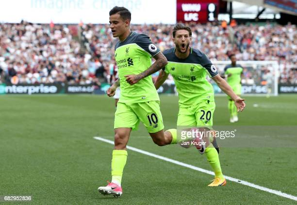 Philippe Coutinho of Liverpool celebrates scoring his sides second goal with Adam Lallana of Liverpool during the Premier League match between West...
