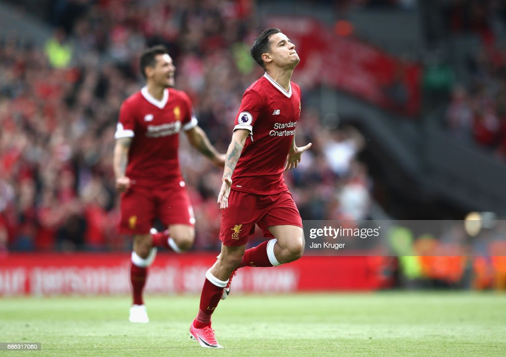 Philippe Coutinho of Liverpool celebrates scoring his sides second goal during the Premier League match between Liverpool and Middlesbrough at Anfield on May 21, 2017 in Liverpool, England.