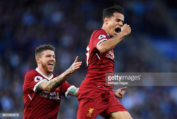 Philippe Coutinho of Liverpool celebrates scoring his sides second goal with Alberto Moreno during the Premier League match between Leicester City...