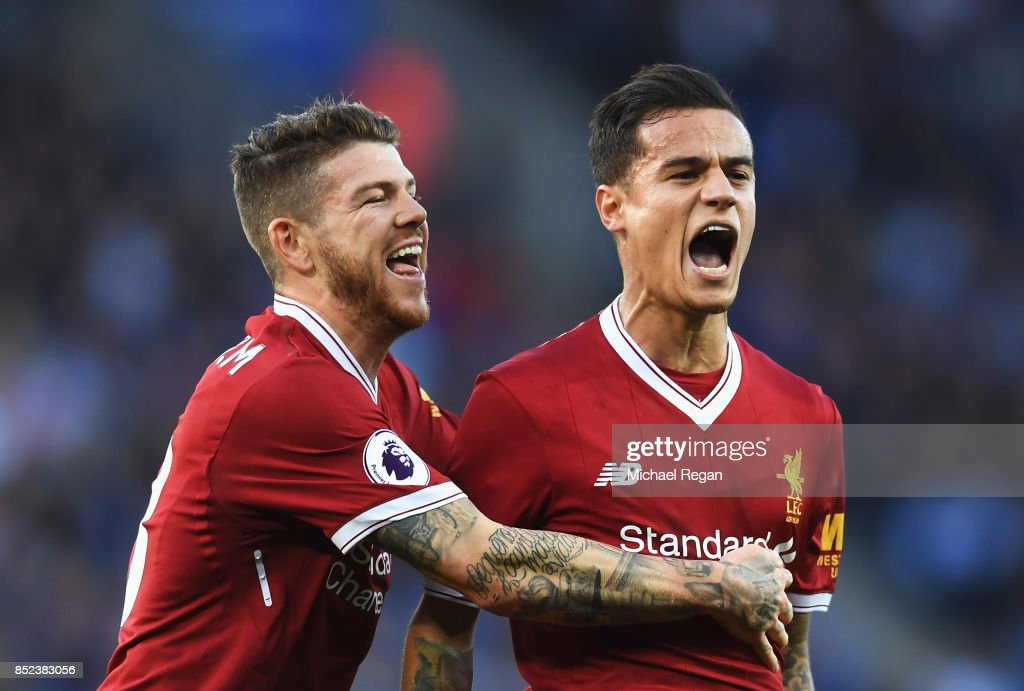 Philippe Coutinho of Liverpool celebrates scoring his sides second goal with Alberto Moreno of Liverpool during the Premier League match between Leicester City and Liverpool at The King Power Stadium on September 23, 2017 in Leicester, England.