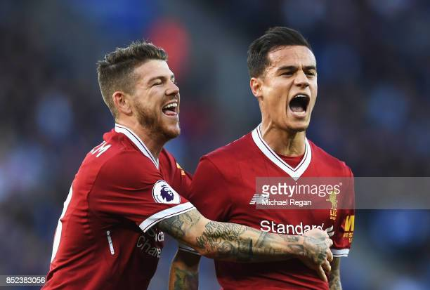 Philippe Coutinho of Liverpool celebrates scoring his sides second goal with Alberto Moreno of Liverpool during the Premier League match between...