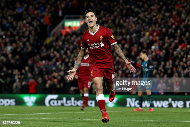 Philippe Coutinho of Liverpool celebrates scoring his side's third goal during the Premier League match between Liverpool and Southampton at Anfield...